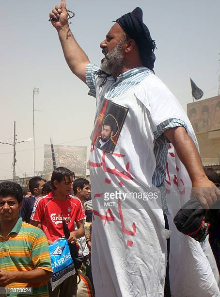 A Sadr supporter stands on a blast wall and lead fellow worshippers to chant 'No No to America No No to America No No to the devil' Friday July 18...