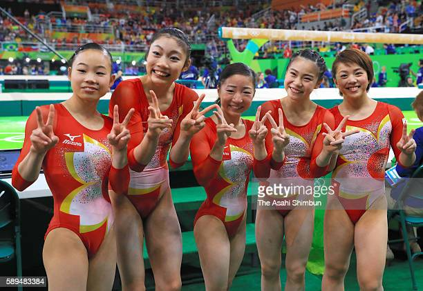 Sae Miyakawa Yuki Uchiyama Asuka Teramoto Aiko Sugihara and Mai Murakami of Japan pose for photographs after competing in the Artistic Gymnastics...