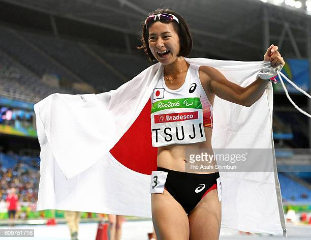 Sae Tsuji of Japan celebrates winning bronze medal in the Women's 400m T47 final on day 7 of the 2016 Rio Paralympic Games at the Olympic Stadium on...