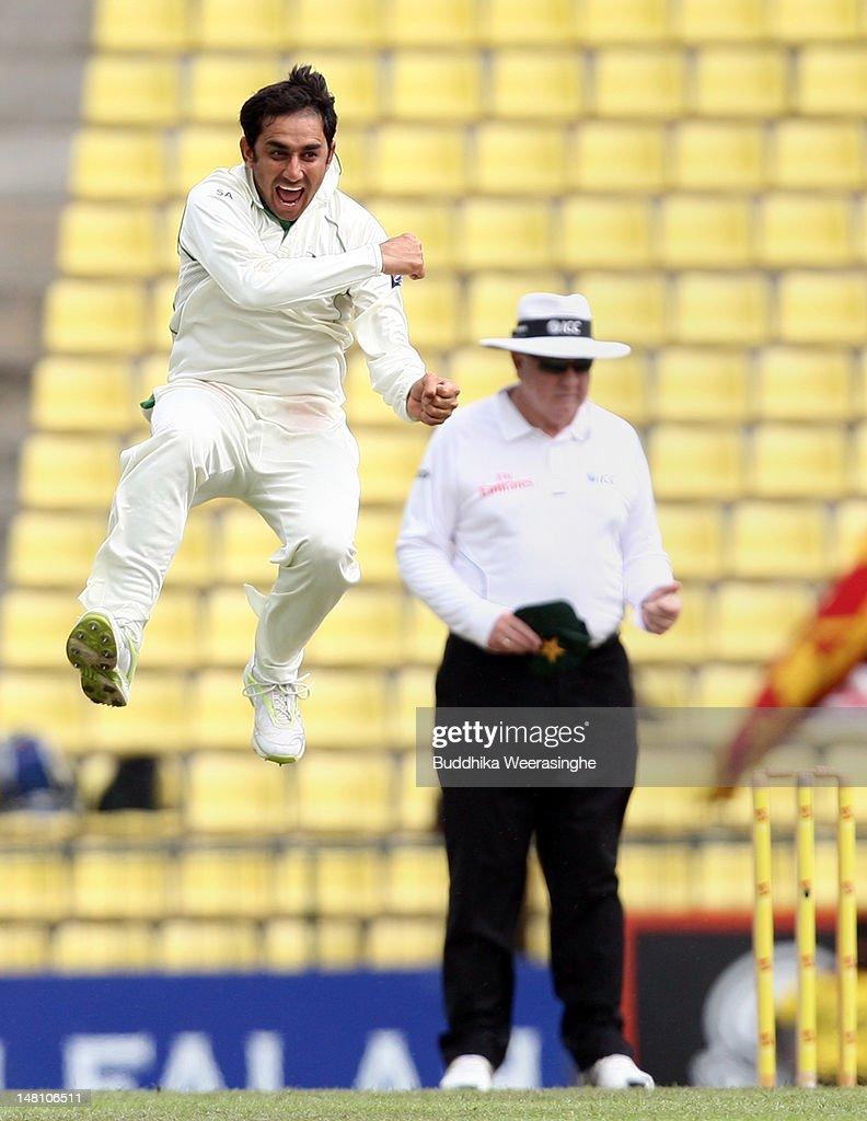 Saeed Ajmal of Pakistan (L) celebrates after taking the wicket of Sri Lankan batsman Tharanga Paranavitana as umpire Steve Davis looks on during day three of the third test between Sri Lanka and Pakistan at Pallekele International Cricket Stadium on July 10, 2012 in Kandy, Sri Lanka.