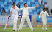 Saeed Ajmal of Pakistan celebrates dismissing James Anderson of England to claim his 7th wicket during the first Test match between Pakistan and...