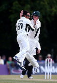 Saeed Ajmal of Worcestershire celebrates with team mate Richard Oliver after taking the wicket of Nicholas Gubbins of Middlesex during day three of...