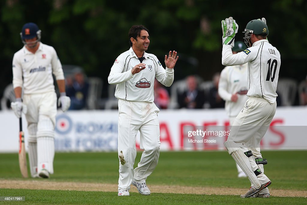 Saeed Ajmal of Worcestershire celebrates with wicketkeeper Ben Cox after capturing the wicket of Jess Ryder of Essex during day three of the LV...