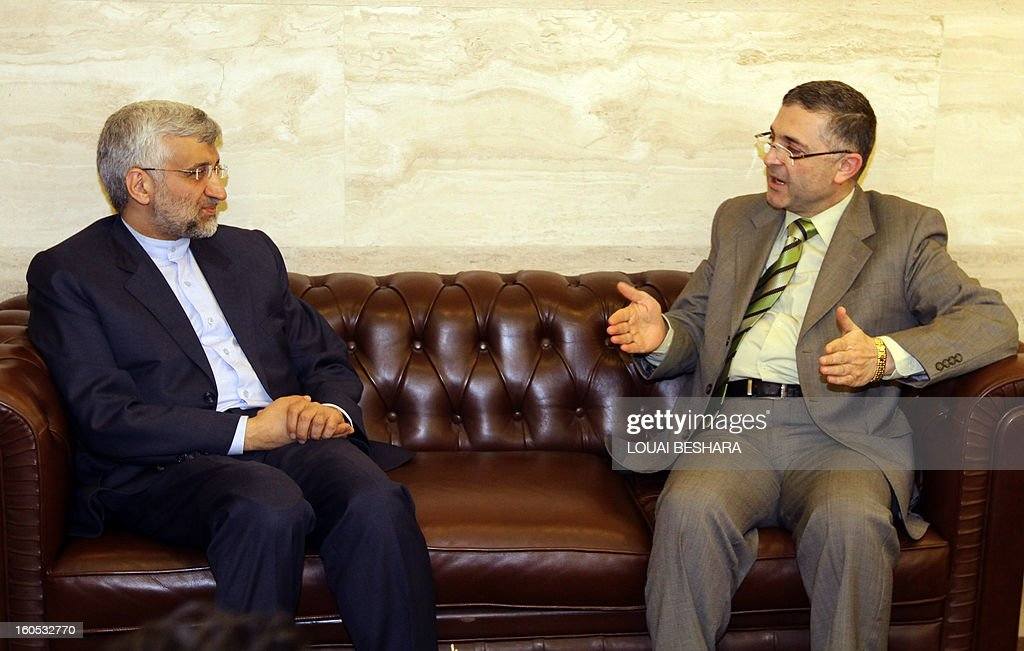 Saeed Jalili (L), who heads the Iranian Supreme National Security Council, meets with Syria Minister of State for National Reconciliation Affairs Ali Haidar in Damascus, on February 2, 2013. Jalili pledged the full support of Tehran for the Syrian regime, its close ally, Syrian state television said.