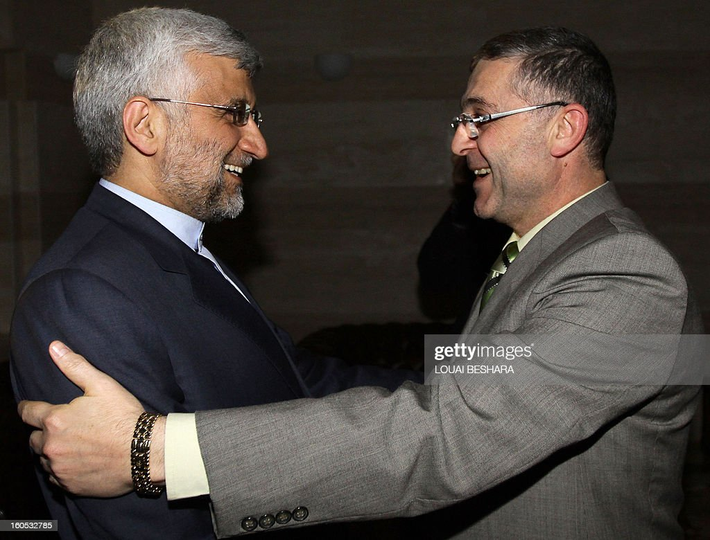 Saeed Jalili (L), who heads the Iranian Supreme National Security Council, is greeted by Syria Minister of State for National Reconciliation Affairs Ali Haidar in Damascus, on February 2, 2013. Jalili pledged the full support of Tehran for the Syrian regime, its close ally, Syrian state television said.