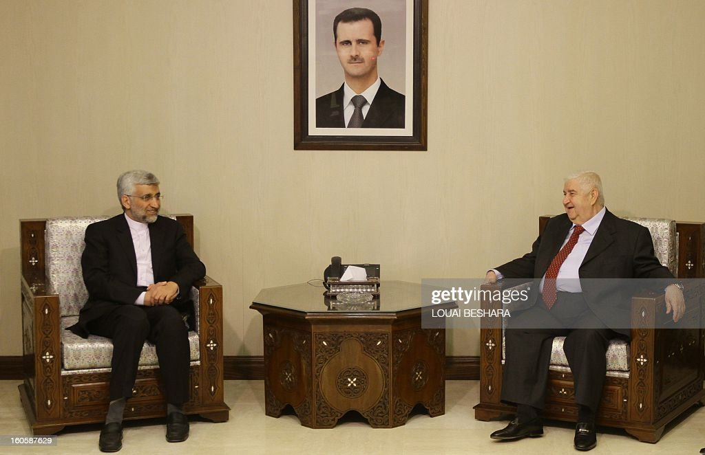 Saeed Jalili (L), who heads the Iranian Supreme National Security Council, talks with Syrian Foreign Minister Walid Muallem during a meeting on February 3, 2013 in Damascus. 'We will give all our support so that Syria remains firm and able to face all the arrogant (Western) conspiracies,' said Saeed Jalili on February 2.