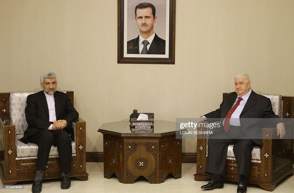 Saeed Jalili (L), who heads the Iranian Supreme National Security Council, poses with Syrian Foreign Minister Walid Muallem prior to a meeting on February 3, 2013 in Damascus. 'We will give all our support so that Syria remains firm and able to face all the arrogant (Western) conspiracies,' said Saeed Jalili on February 2.