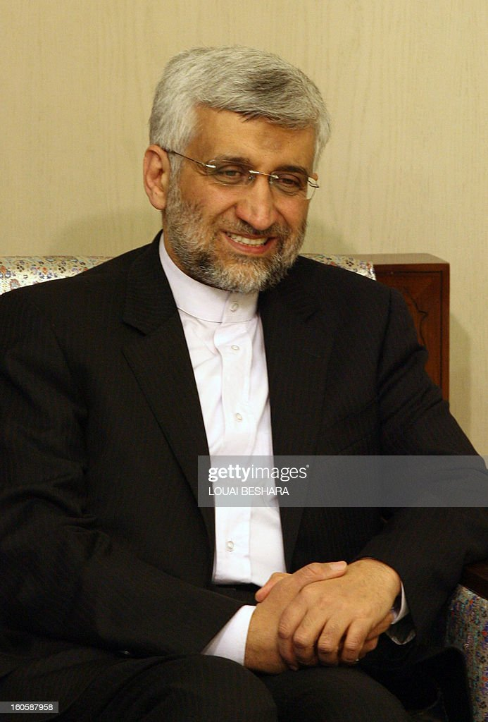 Saeed Jalili, who heads the Iranian Supreme National Security Council, smiles as he meets Syrian Foreign Minister during a meeting on February 3, 2013 in Damascus. 'We will give all our support so that Syria remains firm and able to face all the arrogant (Western) conspiracies,' said Saeed Jalili on February 2.