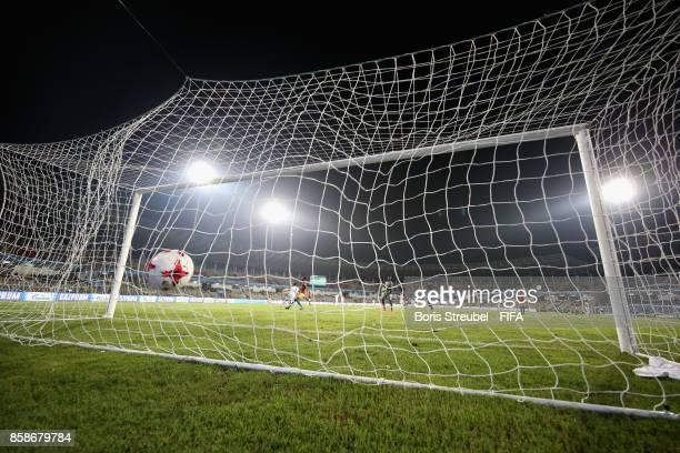 Saeid Karimi of Iran scores his team's third goal against goalkeeper Ibrahima Sylla of Guinea during the FIFA U17 World Cup India 2017 group C match...