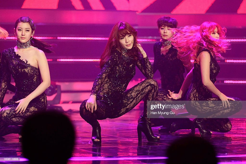 Saem (C) of South Korean girl group Rania performs onstage during the MBC Music 'Show Champion' at Uniqlo-AX Hall on March 13, 2013 in Seoul, South Korea.