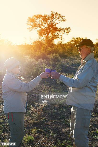 Safari guests toasting  during sundowner in the bush,South Africa
