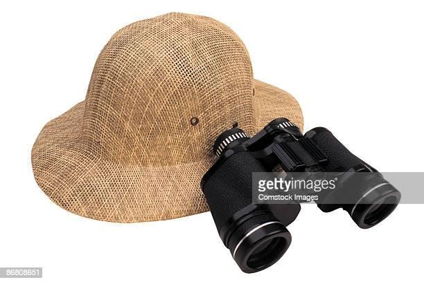 Safari hat and binoculars