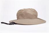 Khaki adventure hat on a white surface. Safari hat isolated on white background.