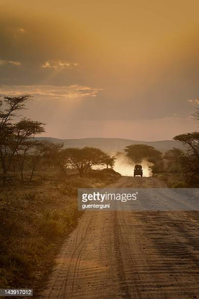 Safari vehicle at sunset, Serengeti, Africa