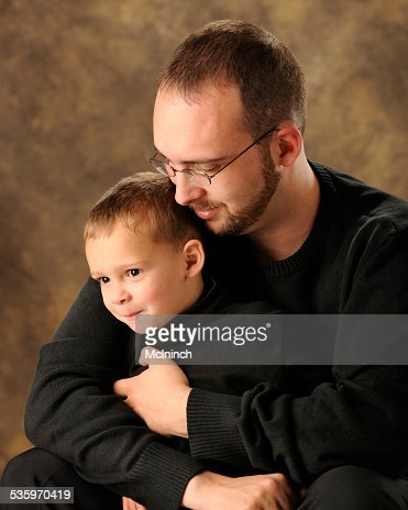 Safe in Daddy's Arms : Stock Photo