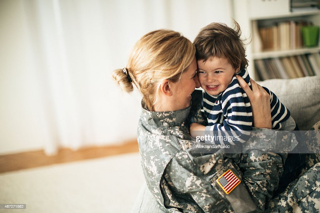 Safe in mommy soldier's hug : Stock Photo
