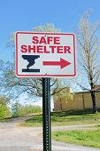 Safe shelter directional sign