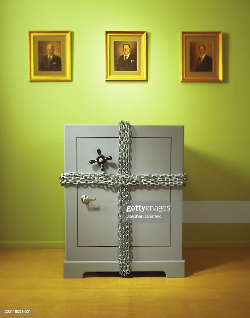 Safe wrapped with chain in office : Stock Photo