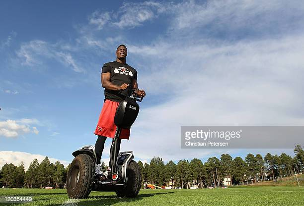 Safety Adrian Wilson of the Arizona Cardinals leaves on a segway following the team training camp at Northern Arizona University on August 4 2011 in...