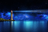 A lighthouse on a tropical island on the ocean with a beam of light in the night sky with stars
