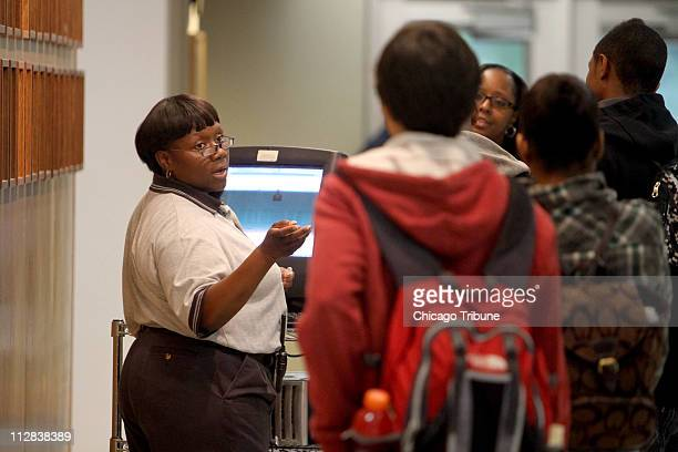 Safety and security officer Andrea Bell processes the long line of tardy students who missed the 8 am first period bell at Oak Park River Forest High...