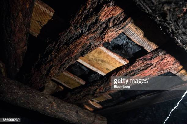 Safety beams support an underground coal mine shaft in Nailakh Ulaanbaatar Mongolia on Thursday March 16 2017 Mongolia exported 81 million tons of...