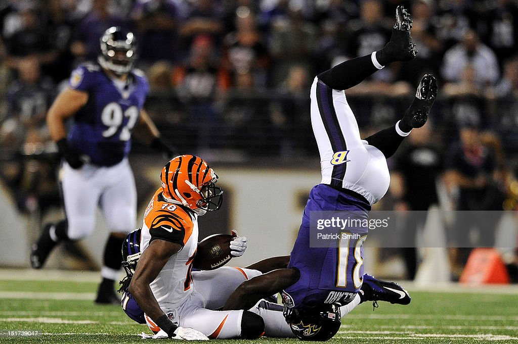 Safety Bernard Pollard #31 of the Baltimore Ravens flips over wide receiver A.J. Green #18 of the Cincinnati Bengals as he makes a tackle in the second quarter at M&T Bank Stadium on September 10, 2012 in Baltimore, Maryland.