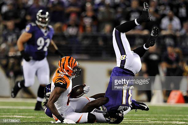 Safety Bernard Pollard of the Baltimore Ravens flips over wide receiver AJ Green of the Cincinnati Bengals as he makes a tackle in the second quarter...