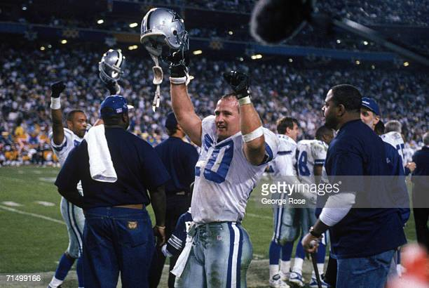 Safety Bill Bates of the Dallas Cowboys celebrates on the sidelines during Super Bowl XXX against the Pittsburgh Steelers at Sun Devil Stadium on...