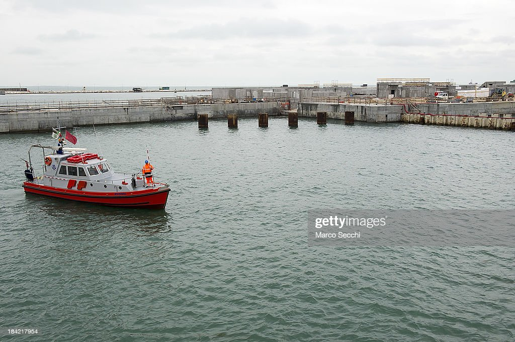 A safety boat patrols one of the areas where the gates housing is built on October 12, 2013 in Venice, Italy. The Mose project works towards protecting Venice from high tides and flooding.
