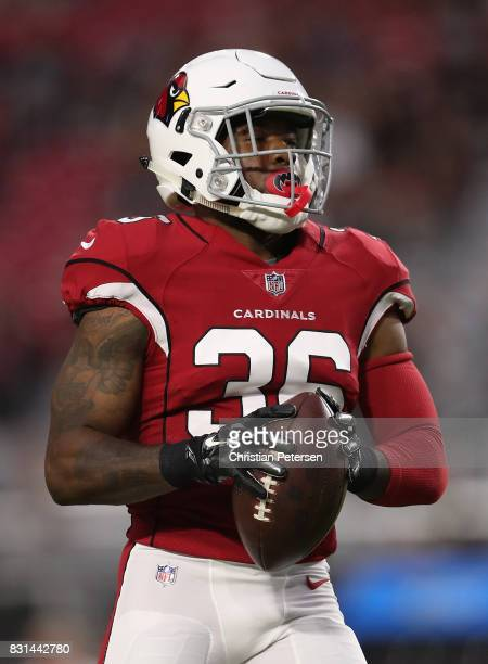 Safety Budda Baker of the Arizona Cardinals warms up before the NFL game against the Oakland Raiders at the University of Phoenix Stadium on August...