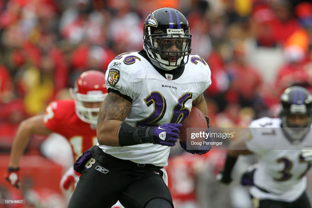 Safety <a gi-track='captionPersonalityLinkClicked' href=/galleries/search?phrase=Dawan+Landry&family=editorial&specificpeople=575013 ng-click='$event.stopPropagation()'>Dawan Landry</a> #26 of the Baltimore Ravens runs back an interception of quarterback Matt Cassel #7 of the Kansas City Chiefs in the third quarter of their 2011 AFC wild card playoff game at Arrowhead Stadium on January 9, 2011 in Kansas City, Missouri.