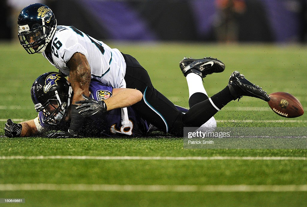 Safety <a gi-track='captionPersonalityLinkClicked' href=/galleries/search?phrase=Dawan+Landry&family=editorial&specificpeople=575013 ng-click='$event.stopPropagation()'>Dawan Landry</a> #26 of the Jacksonville Jaguars tackles tight end Billy Bajema #86 of the Baltimore Ravens in the first quarter at M&T Bank Stadium on August 23, 2012 in Baltimore, Maryland.