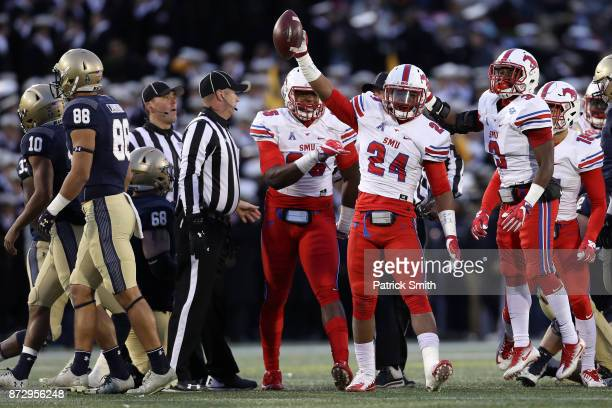 Safety Delano Robinson of the Southern Methodist Mustangs celebrates a recovered fumble against the Navy Midshipmen during the second quarter at...