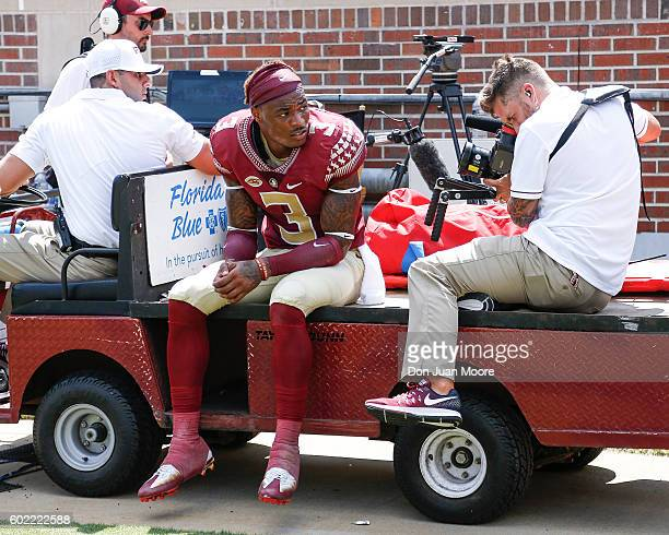 Safety Derwin James of the Florida State Seminoles is carted off the field after hurting his knee during the game against the Charleston Southern...