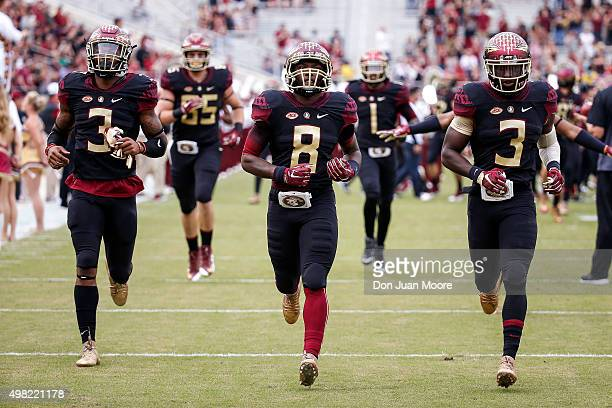 Safety Derwin James Wide Receiver Kermit Whitfield and Wide Receiver Jesus 'Bobo' Wilson of the Florida State Seminoles enter the field sporting the...