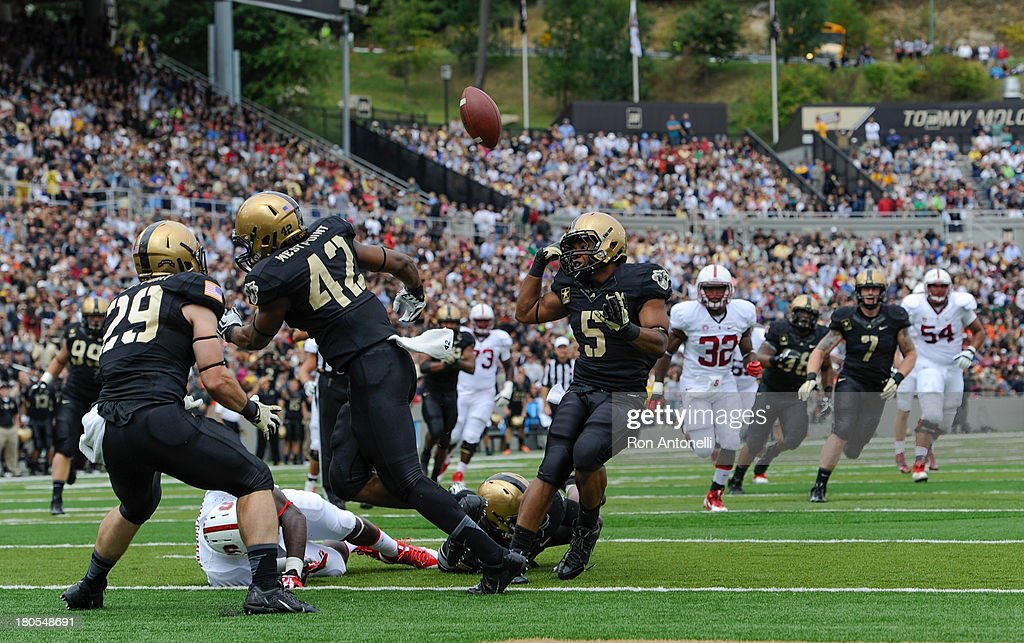 Safety Devon Carrington #5 of Army and linebacker Julian Holloway #42 collide and can't come up with the interception in the 1st half September 14, 2013 at Michie Stadium in West Point, New York. . Stanford defeated Army 24-20.