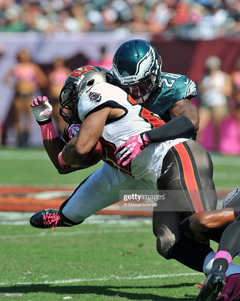 Safety Earl Wolff #28 of the Philadelphia Eagles tackles running back Doug Martin #22 of the Tampa Bay Buccaneers October 13, 2013 at Raymond James Stadium in Tampa, Florida. The Eagles won 31 - 20.
