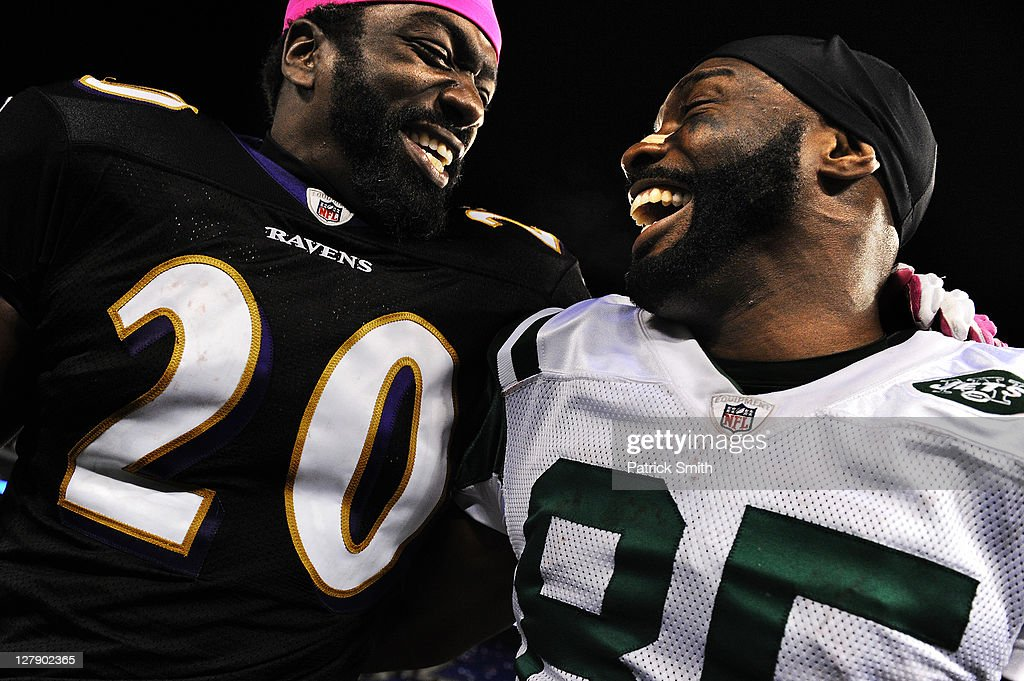 Safety <a gi-track='captionPersonalityLinkClicked' href=/galleries/search?phrase=Ed+Reed+-+American+Football+Player&family=editorial&specificpeople=194933 ng-click='$event.stopPropagation()'>Ed Reed</a> #20 of the Baltimore Ravens and wide receiver Derrick Mason #85 of the New York Jets, who is a former teammate, share a laugh after the NFL football game at M&T Bank Stadium on October 2, 2011 in Baltimore, Maryland. Baltimore Ravens won, 34-17.