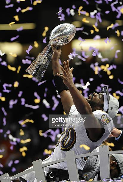 Safety Ed Reed of the Baltimore Ravens hoists the Lombardi Trophy after defeating the San Francisco 49ers in Super Bowl XLVII at MercedesBenz...