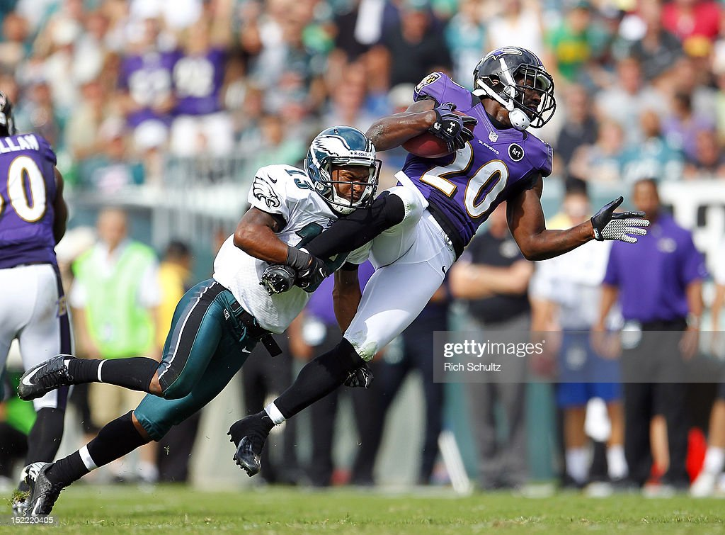 Safety <a gi-track='captionPersonalityLinkClicked' href=/galleries/search?phrase=Ed+Reed&family=editorial&specificpeople=194933 ng-click='$event.stopPropagation()'>Ed Reed</a> #20 of the Baltimore Ravens is tackled by wide receiver Damaris Johnson #13 of the Philadelphia Eagles after Reed intercepted a Michael Vick pass intended for Johnson in the third quarter during a game at Lincoln Financial Field on September 16, 2012 in Philadelphia, Pennsylvania. The Eagles defeated the Ravens 24-23.