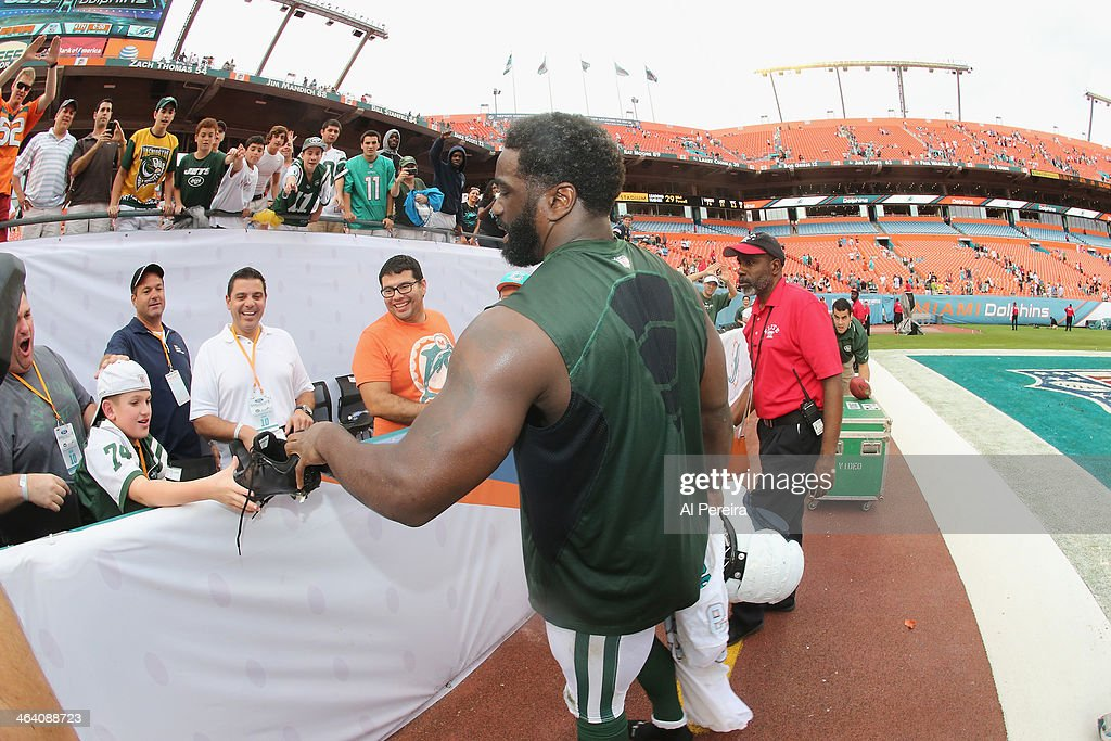 Safety <a gi-track='captionPersonalityLinkClicked' href=/galleries/search?phrase=Ed+Reed&family=editorial&specificpeople=194933 ng-click='$event.stopPropagation()'>Ed Reed</a> #22 of the New York Jets hands his shoes to a fan after the game against the Miami Dolphins at Sun Life Stadium on December 29, 2013 in Miami Gardens, Florida.