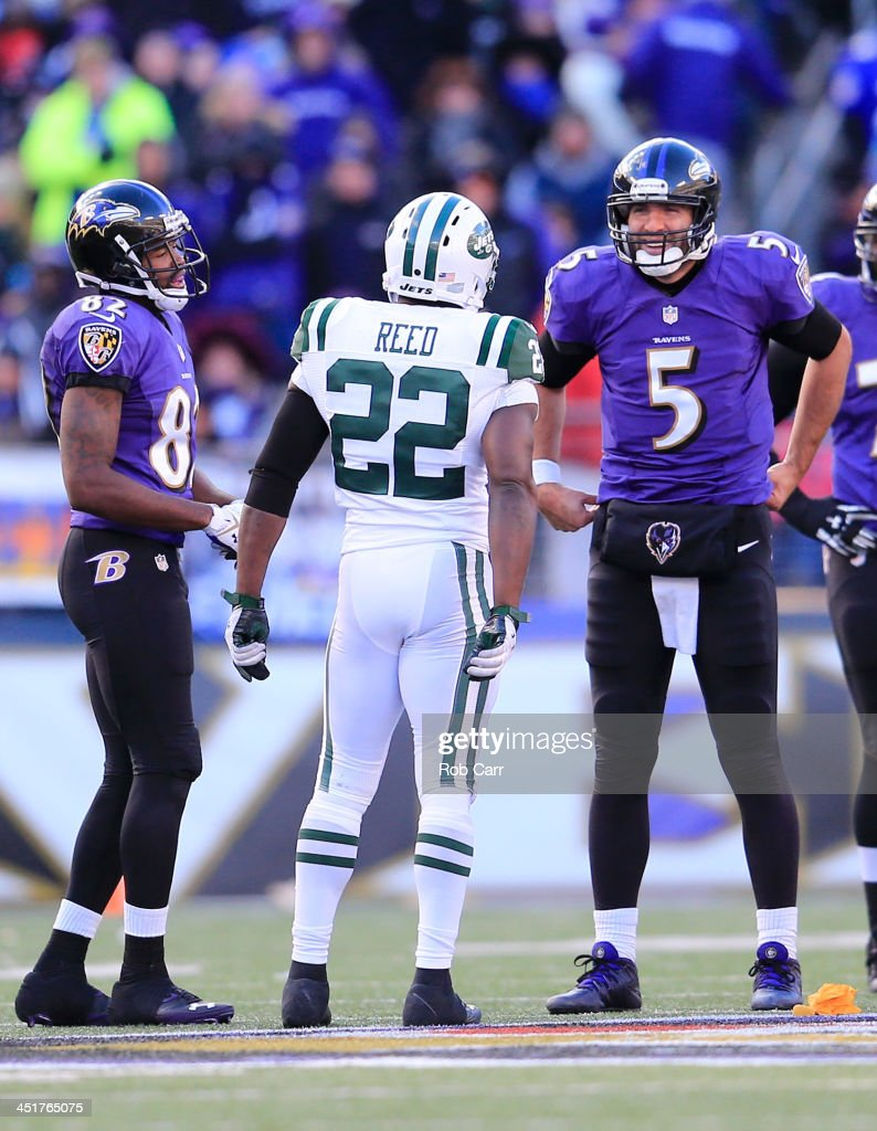 Safety <a gi-track='captionPersonalityLinkClicked' href=/galleries/search?phrase=Ed+Reed&family=editorial&specificpeople=194933 ng-click='$event.stopPropagation()'>Ed Reed</a> #22 of the New York Jets talks with quarterback <a gi-track='captionPersonalityLinkClicked' href=/galleries/search?phrase=Joe+Flacco&family=editorial&specificpeople=4645672 ng-click='$event.stopPropagation()'>Joe Flacco</a> #5 and wide receiver <a gi-track='captionPersonalityLinkClicked' href=/galleries/search?phrase=Torrey+Smith&family=editorial&specificpeople=5527843 ng-click='$event.stopPropagation()'>Torrey Smith</a> #82 of the Baltimore Ravens during the second half of the Ravens 19-3 at M&T Bank Stadium on November 24, 2013 in Baltimore, Maryland.