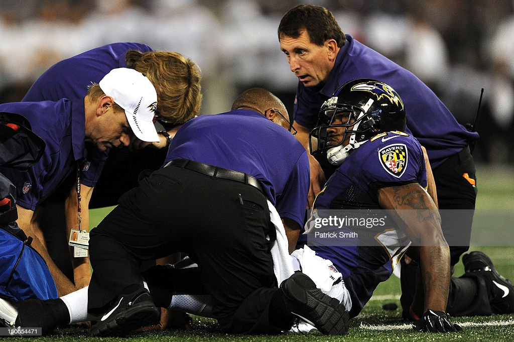 Safety Emanuel Cook #26 of the Baltimore Ravens winches in pain before being carted off the field against the Jacksonville Jaguars in the third quarter at M&T Bank Stadium on August 23, 2012 in Baltimore, Maryland. The Baltimore Ravens won, 48-17.
