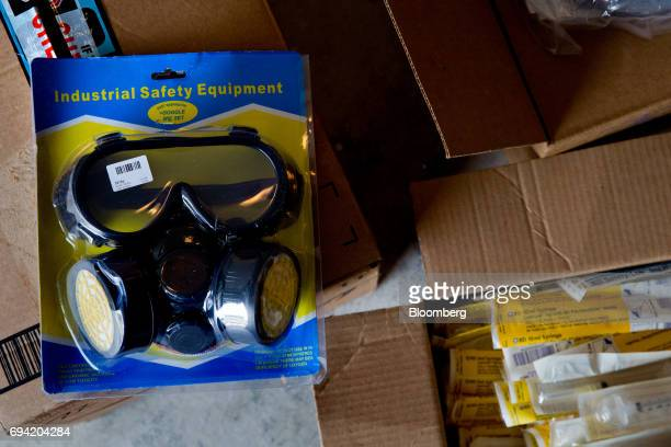 Safety equipment sits on boxes of supplies to aid protesters collected by the Venezuelan exile group Politically Persecuted Venezuelans in Exile...