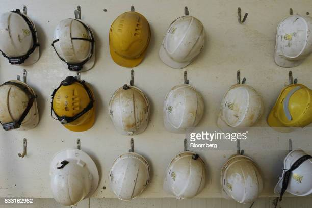 Safety helmets hang from pegs on a wall at the St Ives Gold Mine operated by Gold Fields Ltd in Kambalda Australia on Wednesday Aug 9 2017 Global...