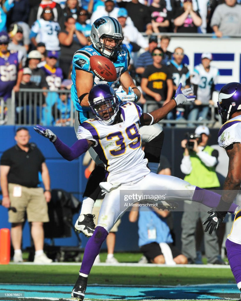 Safety <a gi-track='captionPersonalityLinkClicked' href=/galleries/search?phrase=Husain+Abdullah&family=editorial&specificpeople=2190074 ng-click='$event.stopPropagation()'>Husain Abdullah</a> #39 of the Minnesota Vikings breaks up a pass to tight end <a gi-track='captionPersonalityLinkClicked' href=/galleries/search?phrase=Greg+Olsen&family=editorial&specificpeople=2166920 ng-click='$event.stopPropagation()'>Greg Olsen</a> #88 of the Carolina Panthers October 30, 2011 at Bank of America Stadium in Charlotte, North Carolina. The Vikings won 24 - 21.