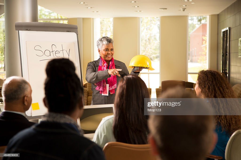Safety in the workplace. Presentation with office workers. : Stock Photo