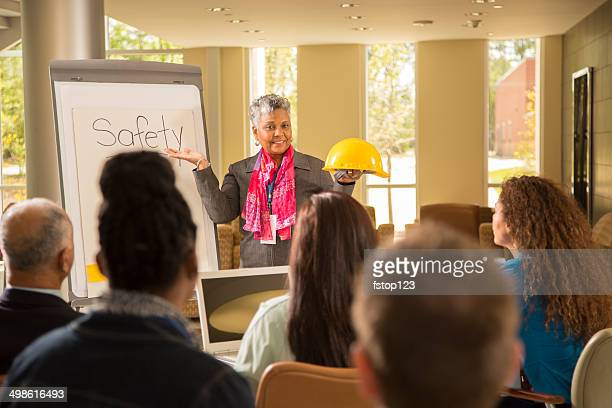 Safety in the workplace. Presentation with workers.