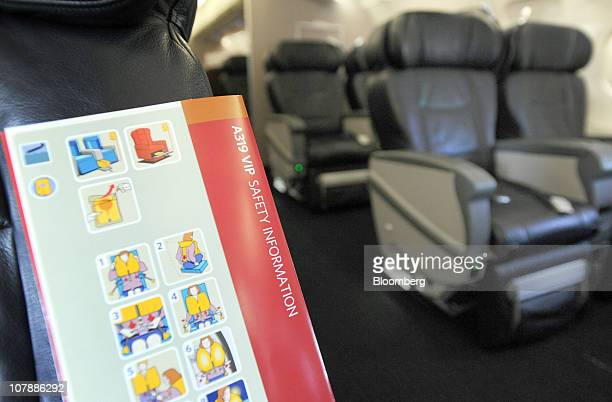 A safety information card is shown aboard a specially outfitted Airbus A319 used for NBA basketball teams at the HartsfieldJackson Atlanta...